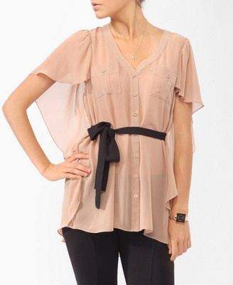 This blouse is lovely & feminine. It would look chic with white or black skinny jeans.