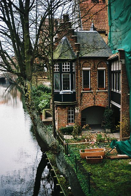 Super cute little cottage house along the river in bruges, belgium