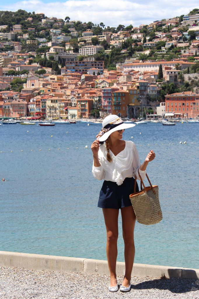 Sun hat + breezy white top + navy blue shorts + straw tote