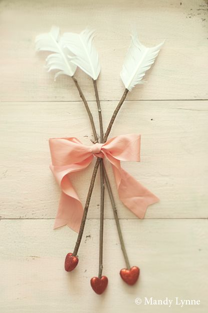 Adorable idea for making cupid arrows! This photographer has a stunning…