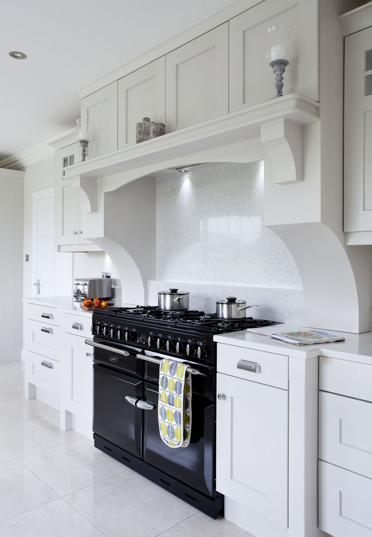 This bespoke over mantle by Dorans Kitchen & Home frames the range cooker and creates an elegant contrast.