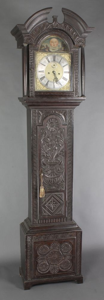 """Lot 726, William Tipling, an 18th Century 8 day striking longcase clock, the 11"""" brass arch shaped dial painted moon and landscape, with silvered dial, Roman numerals, subsidiary second hand and calendar aperture, the dial marked William Tipling  Leeds Fecit, contained in a later associated carved oak case 86""""h, est £200-300"""