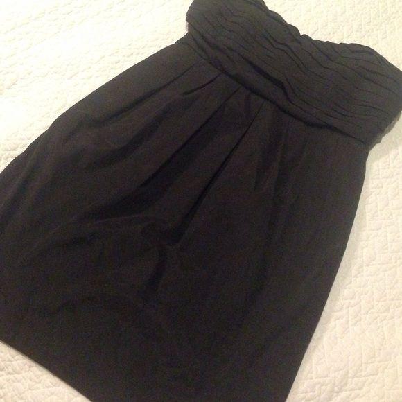 Asos cocktail dress Flattering black, strapless dress.  Pockets! Cute back detail! ASOS Dresses