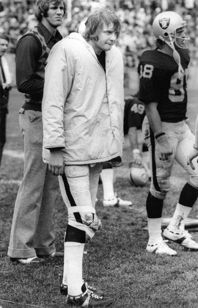 RAIDERS SUNDAY November 11, 1973 - An injured Kenny Stabler watches from the sidelines with an ice pack tied to his knee. (Ron Riesterer / Oakland Tribune)