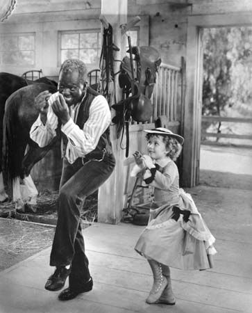 Bill Bojangles Robinson. (Using young black children in vaudeville acts was popular and represented a unique employment opportunity for talented kids. They usually sang and danced, and occasionally played musical instruments for the dimes and quarters he would make in beer gardens and burlesque houses). Orphaned shortly after his birth in 1878, he was raised by a grandmother for a few years.