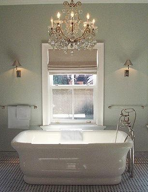 Beautiful bathroom with Chandelier above the tub.a great idea to get this  look without having to rewire.is to hang a candle chandelier above your tub!