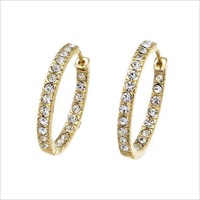 Hoop earrings, made of gold plated metal, with encrusted clear Swarovski® Elements crystals. Siz Ø 2.3 cm.