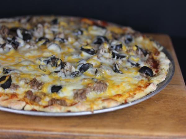 Homemade pizza is an easy to make, inexpensive meal. If you use ground beef for a simple hamburger pizza it is even more budget friendly.