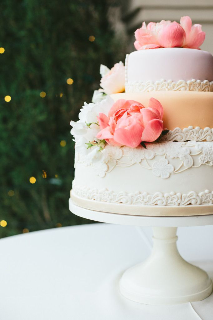 wedding cake with flowers Travis J | Snippet & Ink #wedding #cakes #peach #pink #3tier