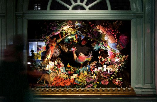 Wild animals made of intricately folded coloured paper fill a window at Fortnum and Mason