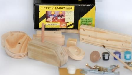Order this DIY TRACTOR with a paint set, hardware, glue and a building plan from kobus@littleengineer.co.za @ R190.00.  Size:  220 x 70 x 70mm.