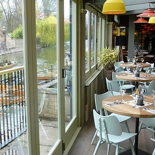 Ercol Butterfly Chairs by the river in Cambridge in a Las Iguanas restaurant.
