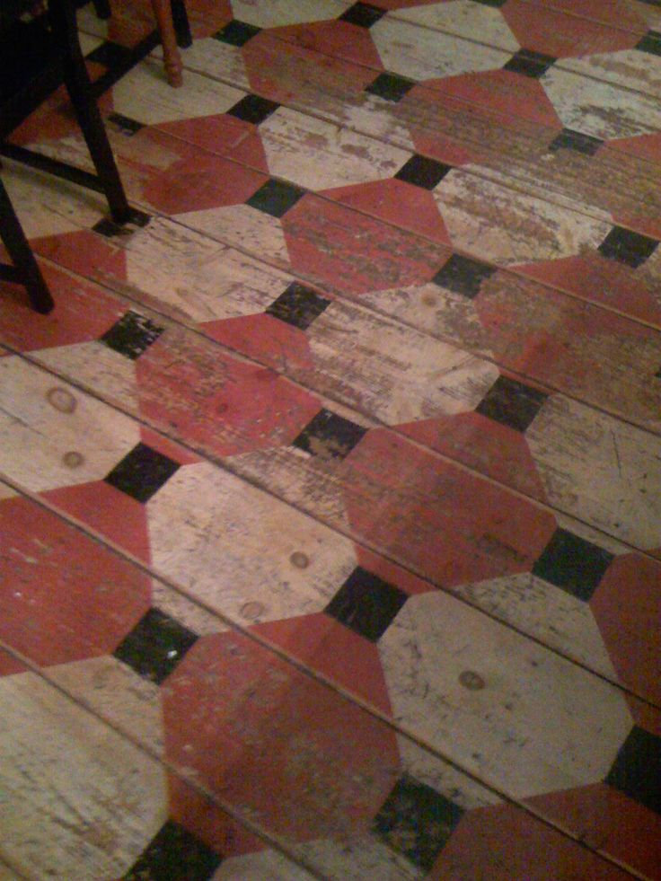 Primitive Painted Wood Floor. I love this look, you could recreate it and then sand it down to achieve this worn look on a new floor.