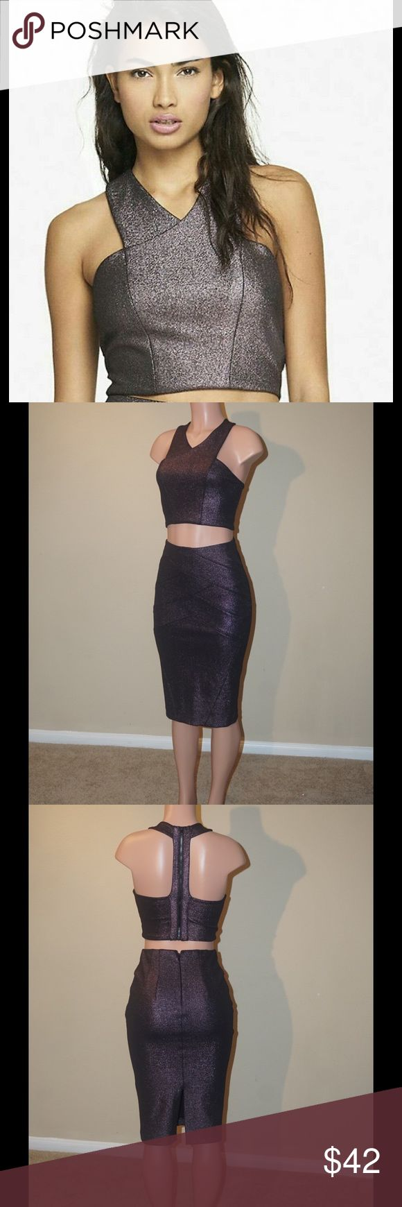 Purple Crop Top Cute and comfortable metallic crop top, perfect to pair with the matching high waist skirt [sold separately] or black pants. Worn once. Polyester/Spandex - Hand Wash Clean. All items professionally cleaned.* Express Tops Crop Tops