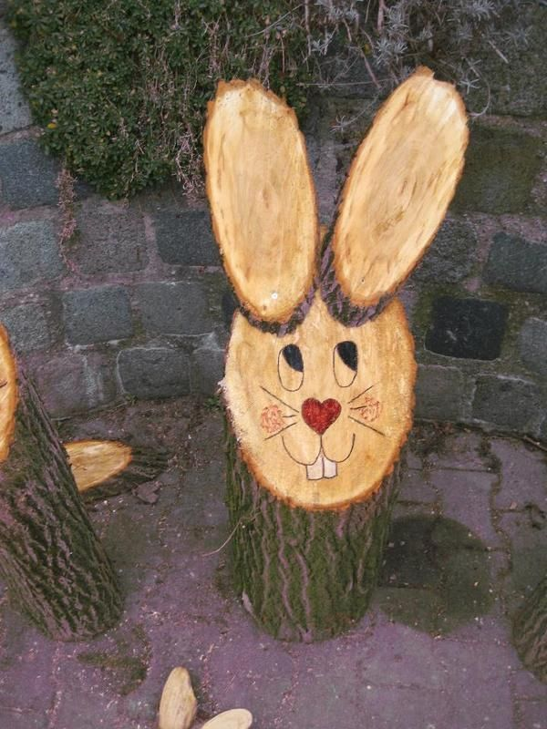 Bunny made from a log and wood slices. So cute!