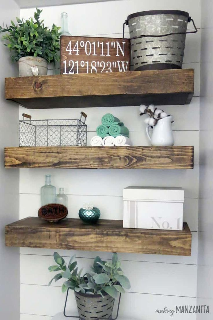 Love these floating shelves above the toilet decorated with farmhouse style! Lov…   – bathroom shelves
