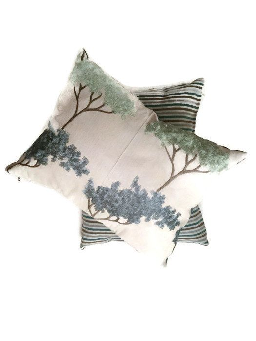 Chic decor ideas for home! Decorative couch pillow embroidered with chic navy and teal tree pattern and shophisticated linen striped fabric on the back. Bonsai Garden in Mineral luxury decorative pillow by MyCusionBoutique.