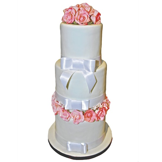 Vanilla & pink roses.  Roses are hand formed and painted sugar.