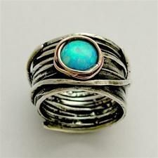Sterling silver integrated rose gold ring w/ inlaid blue opal.: Opals Rings, Birds Nests, Blue Opals, Sterling Silver, Ocean Rings, Turquoi Rings, Silver Rings, Rose Gold Rings, Engagement Rings