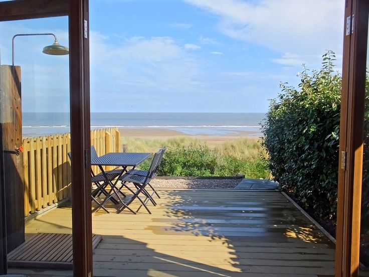 Sitting on top of sand dunes, this cute cottage - small, bright and airy - has glorious views. It's for long walks (dogs, too) and relaxing