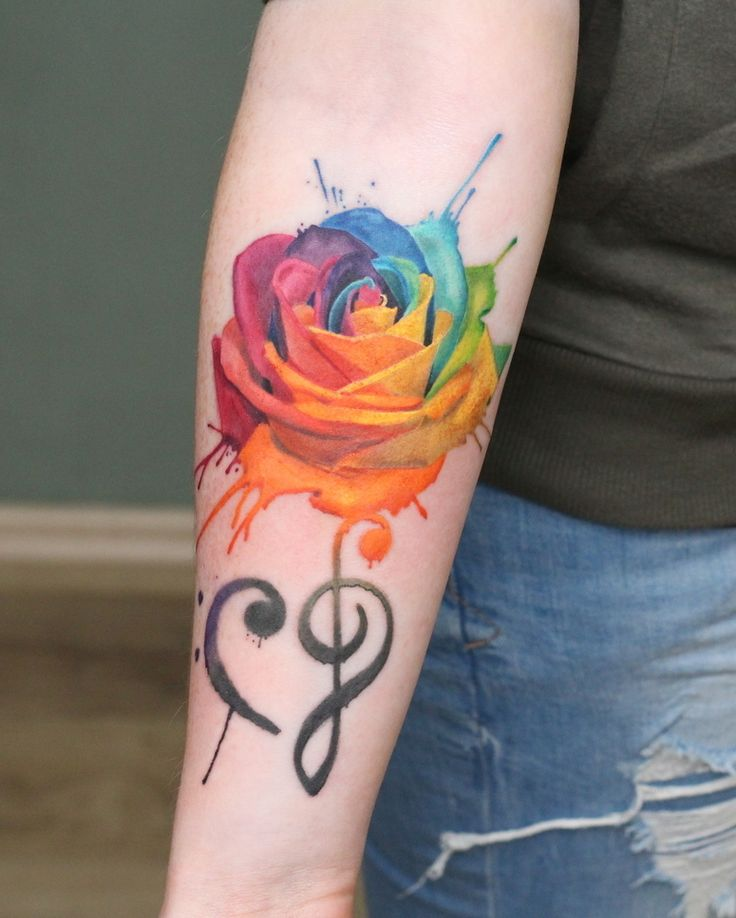 Beautiful colorful rose in watercolors. Stylistics engraved by Mischa. Nice and colorful watercolor rose tattoo done by Misha R Tattooartist.