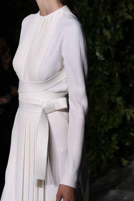 Chic white dress with sharp pleats and crossover belt; Valentino