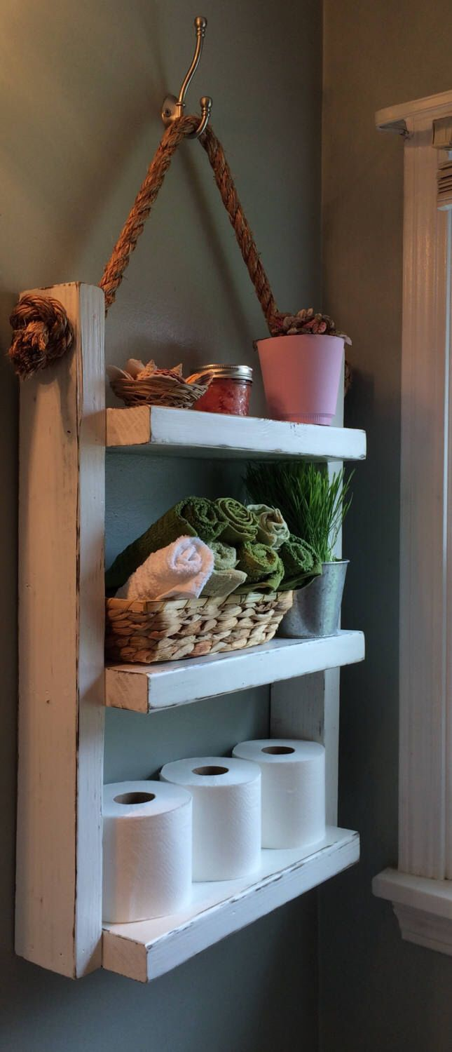 Rope Hanging Shelf, Wooden Ladder Shelf, Storage Shelf, Bathroom Storage,Rustic Shelf, Over The Toilet Storage, Bathroom Towel Rack, White by LakeViewWood on Etsy https://www.etsy.com/listing/521061495/rope-hanging-shelf-wooden-ladder-shelf