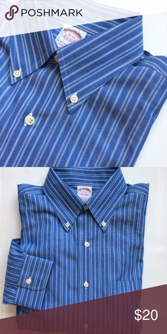 Brooks brothers non iron dress shirt 15-33 Brooks brothers non iron dress shirt. Size 15-33. Blue with white stripes. Mint preowned condition. No rips stains or tears long sleeve button down. Thanks. Brooks Brothers Shirts Dress Shirts