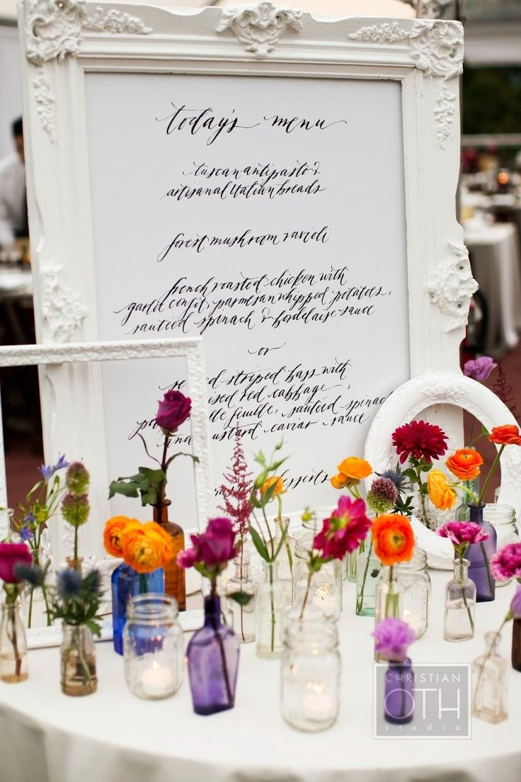 LOVE this decor! The painted white frames, the scattered posies and the calligraphy menu! Just love it! Photography by christianothstudio.com, Event Planning by daughterofdesign.com, Floral & Event Design by hatchcreativestudio.com