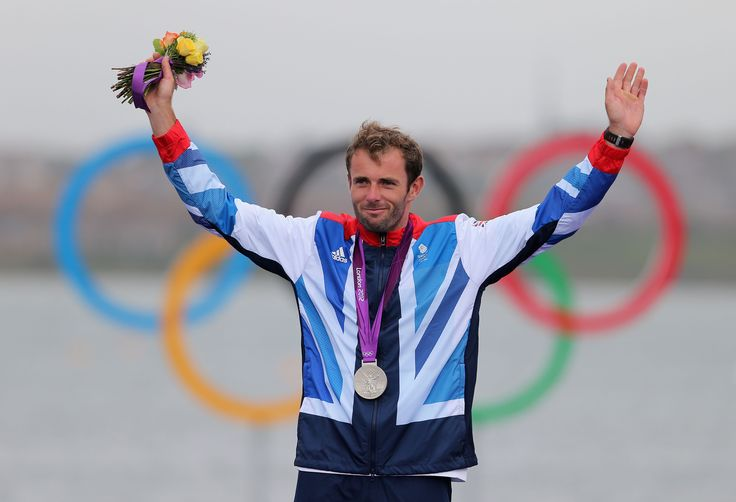 Nick Dempsey celebrating his silver medal in sailing