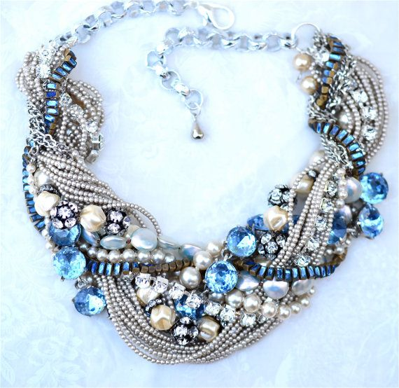 Oh, the vintage madness! I couldnt pass up this huge blue rhinestone link chain. The large pearl strand is hand strung by myself with Swarovski