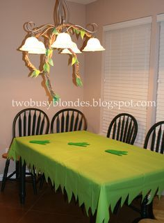 Cut dollar store table cloth to get grass/jungle look.