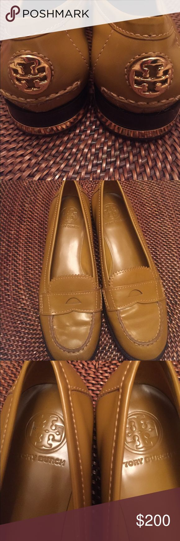 Tory Burch loafers Gorgeous Tory Burch Penny loafers. A Classic with a twist! Genuine leather. In the most amazing cross between mustard yellow and olive green patent leather. Gold heels with stacked mahogany wood look, with gold Tory Burch sign on back of heels. Excellent used condition and very clean. Only worn a handful of times. No wear to the inside of shoe. Classy preppy fabulous FUN! Tory Burch Shoes Flats & Loafers