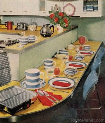 """In a 1950s kitchen, it wasn't uncommon to """"diner-ize"""" the kitchen area. Here, informal meals can be had at a luncheonette style counter."""