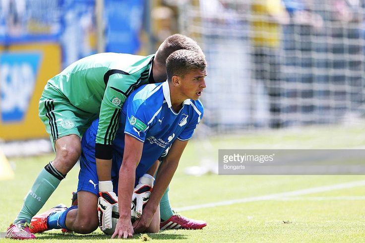 Grischa Proemel of Hoffenheim is challenged by goalkeeper Timon Wellenreuther of Schalke during the A Juniors Bundesliga Semi Final between 1899 Hoffenheim and FC Schalke 04 at Dietmar Hopp-Stadium on June 14, 2014 in Hoffenheim, Germany.