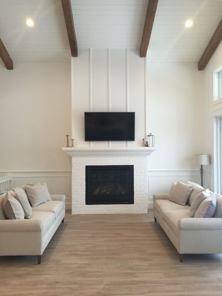 White Living Room With Shiplap Ceiling, Woods Beams, And