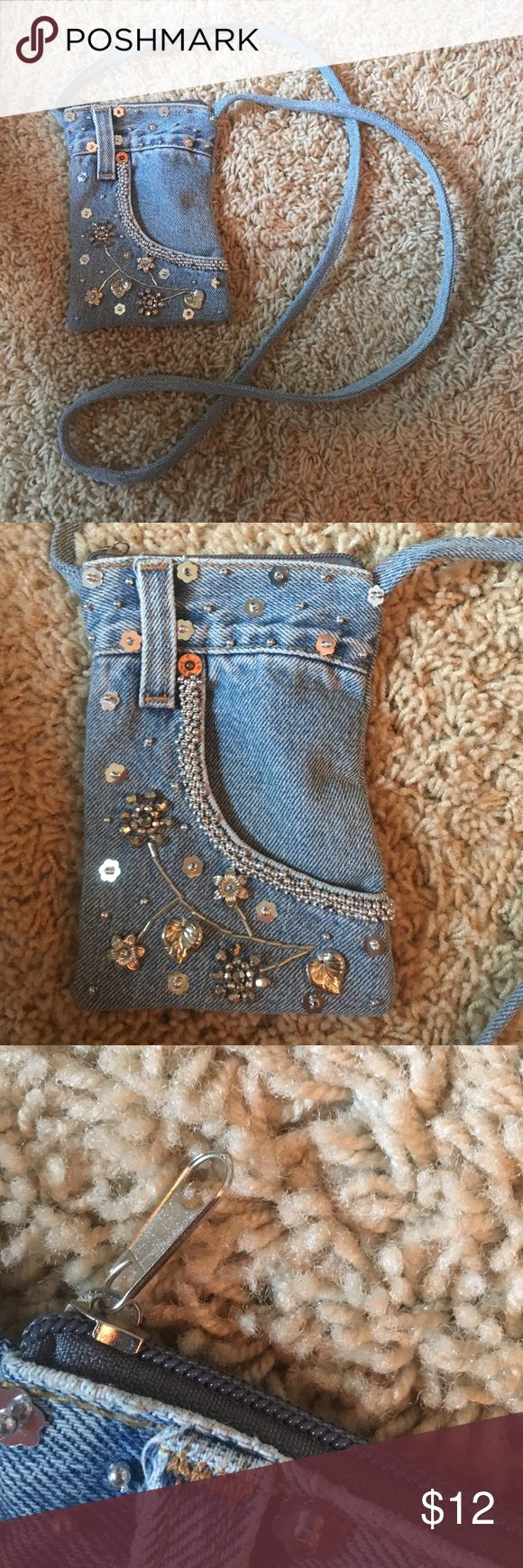 Unique Jean purse Small. Crossbody bag. Made from jeans with flower sequin detail and other various beading. Has one small pocket in the front and zipper at the top Handmade Bags Crossbody Bags