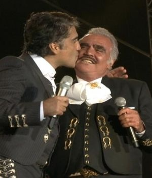 The one on the left kissing his dad on stage. <3 Alejandro Fernandez son & Vicente Fernandez father