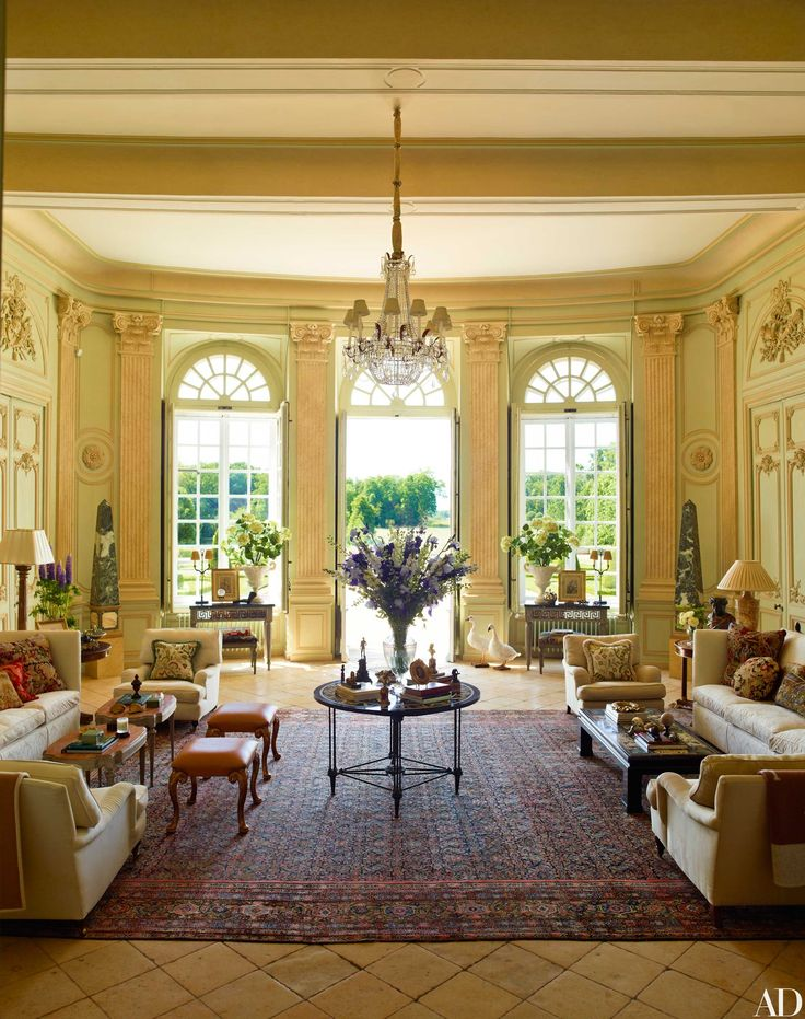 Featuring 22-foot ceilings and limestone floors, the Grand Salon opens directly to the formal gardens, which the French government revived before Corrigan purchased the estate.