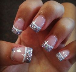 gel nails with glitter tip and white line.
