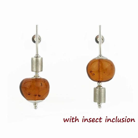 Asymmetrical Balance: Sterling Silver earrings with large Baltic amber beads (one has an insect inclusion!) Designed & made by Agnaart https://www.etsy.com/listing/558317182/amber-earrings-sterling-silver