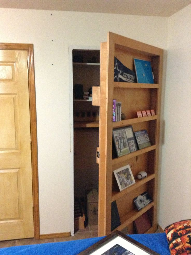 Gun safe and secret door pinned by https://www.concealedfurniture.com
