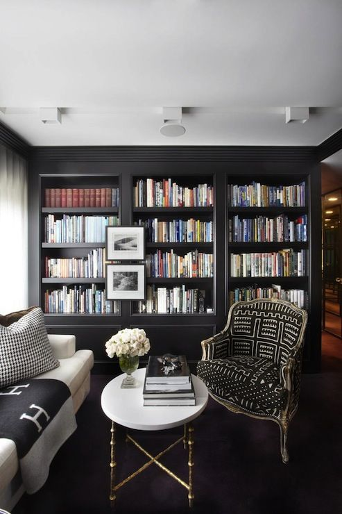 We will be creating bookcases hopefully soon in the dining room area. I like the floating photos. Have seen this before but with books all covered with the same color covers which looked a little more sterile than this look.