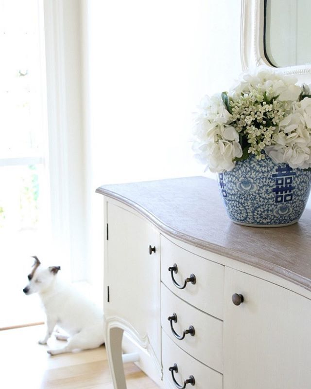 Home entrance.  White hydrangeas in a blue and white ginger jar.