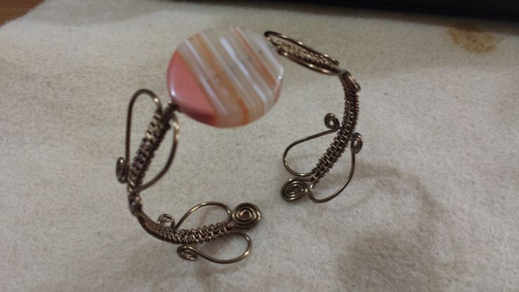 Hand crafted Antique Bronze 1mm wire Bangle with striped shell coin