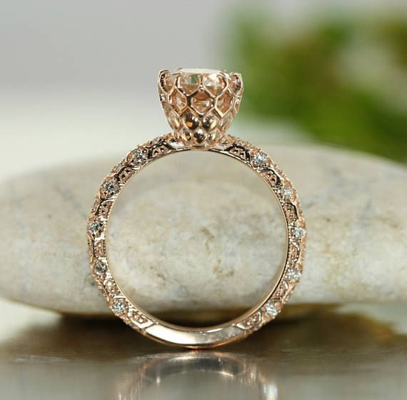 Brighten your day with a burst of beautiful color. This engagement ring consist a round-cut 7x7mm pinkish peach morganite in a gorgeous 10 prong setting with diamonds on the band that illuminated the light of this ring. This ring is suitable for a variety of occasions, whether it is a proposal, engagement, anniversary or any other meaningful moment. One thing for sure is, the special lady who receives this beautiful ring will remember that moment forever.    *** This listing price is for ONE…