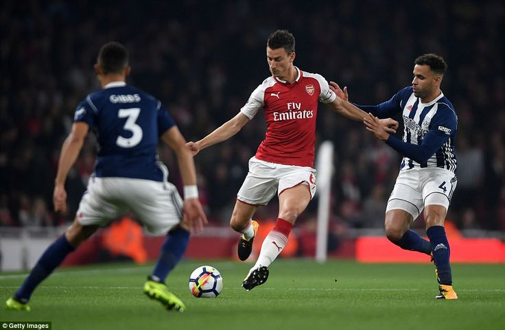 Hal Robson-Kanu tries to close down Arsenal centre back Laurent Koscielny during the first half of the Premier League clash