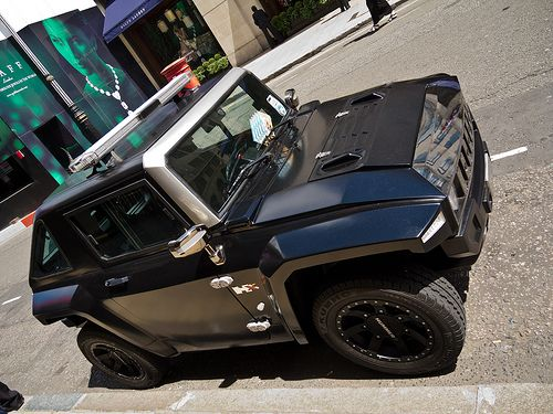 The MEV HUMMER Electric HX in matte black with security light upgrade. Definitely Like Nothing Else™
