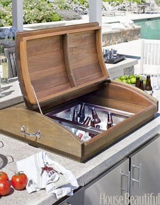 Nantucket outdoor kitchen, could this idea be used at the cabin (cooler under one of the tables).