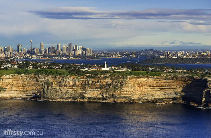 Off the Sydney coast looking west over Watson's Bay Light House with the city centre in the background.